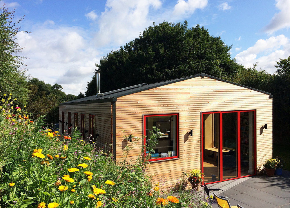 Beautiful view of off-grid eco dwelling near ipswich with meadow flowers out on a summers day