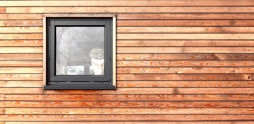 siberian larch cladding with shadow gap and aluminium clad timber framed window