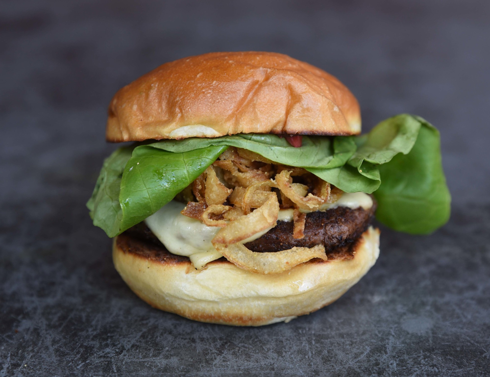 The Royal Scorcher: smoked jalapeno bacon, pepper jack, Serrano strawberry jam, onion straws, butter lettuce, sweet bbq sauce, brioche bun