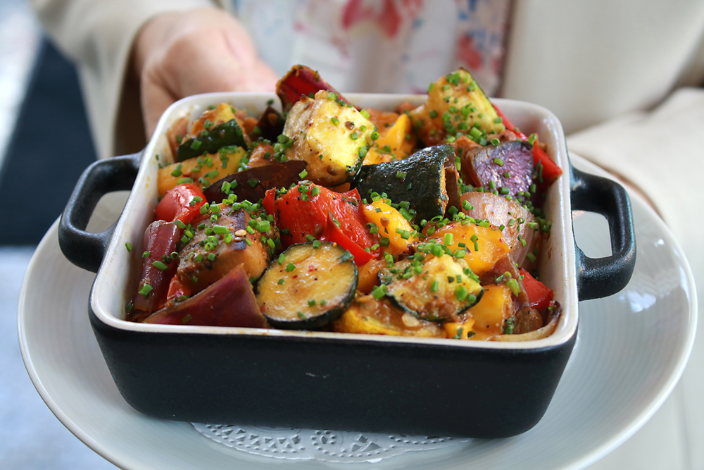 Ratatouille made with heirloom tomatoes, zucchini, eggplant, yellow squash, red onion, and bell peppers.