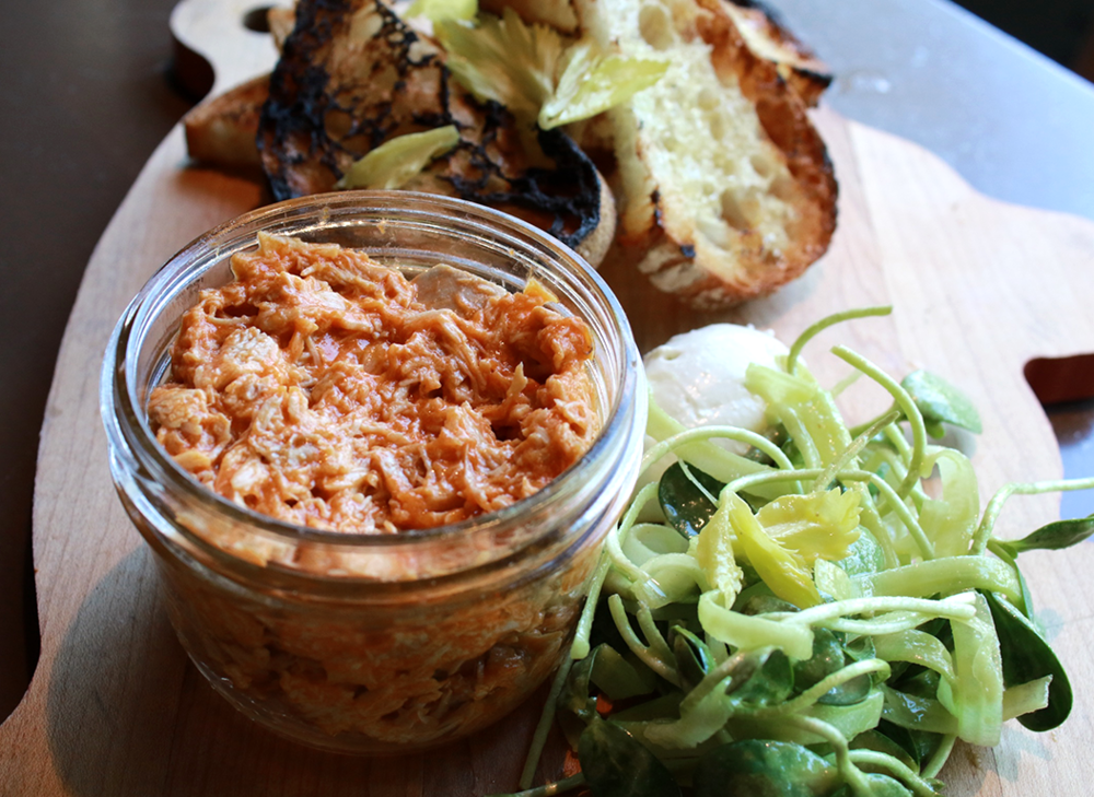 Buffalo Chicken Rillettes with whipped blue cheese, Texas pete, celery salad, and toast.