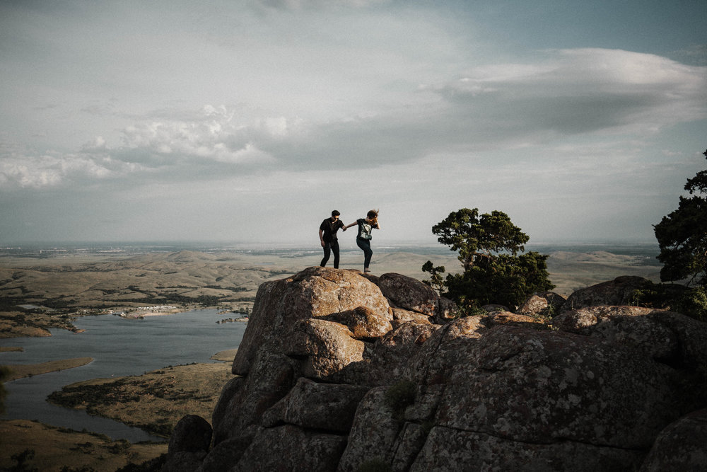 This couple was sitting at the very edge of the rock, and I asked them for permission to take their photo. I thought this photo was cuter than the one of them sitting.