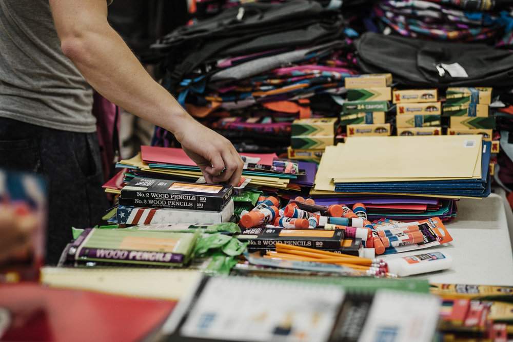 Backpacks were filled with donated school supplies.