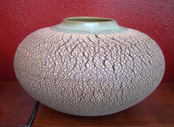 Clay vessel   9″x21″