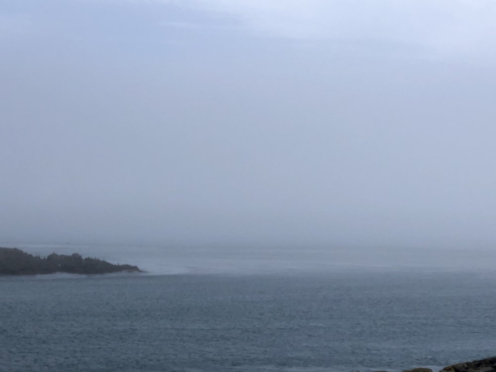 Fog starting to clear over Peter Island.