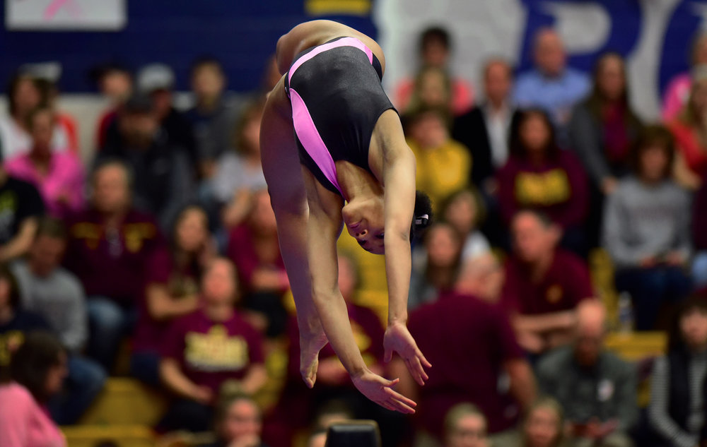Sophomore Nuriya Mack performs on the balance bean during the Kent State gymnastics team's Pink Meet dedicated to breast cancer awareness Sunday Feb. 19. 2017.