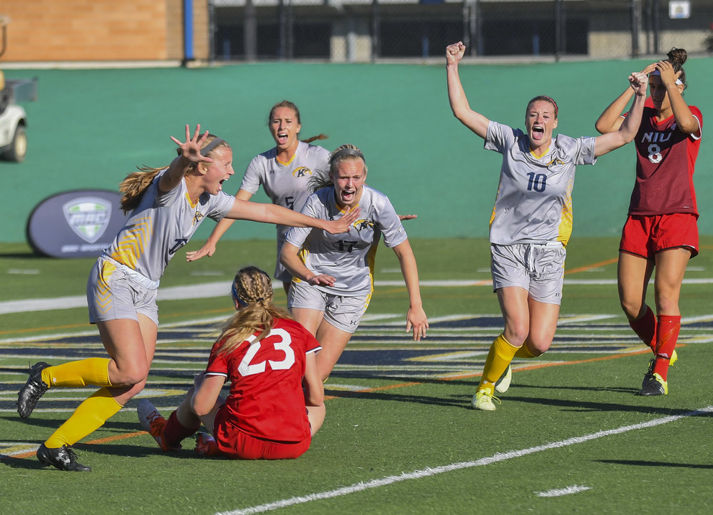 The ladies of the Kent soccer team celebrate after their first goal in the MAC Championship game against Northern Illinois University. The Flashes would go on to win the Championship 1-0 for Kents first ever womens soccer Championship win.