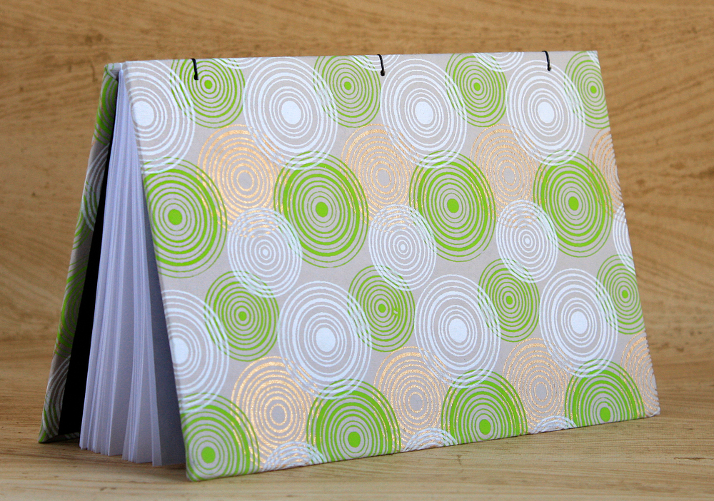 6x9-sketchbook-green-swirls-open-on-side.jpg