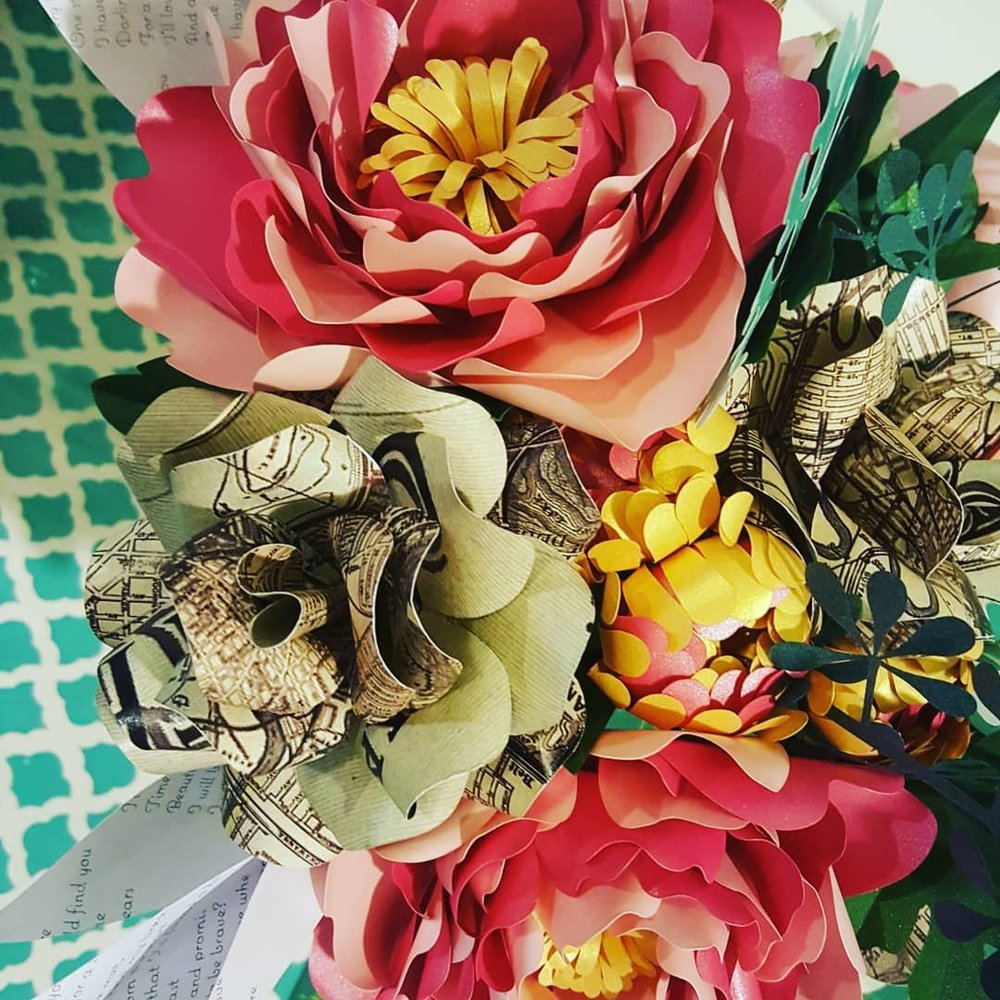 paper flower bouquet with maps
