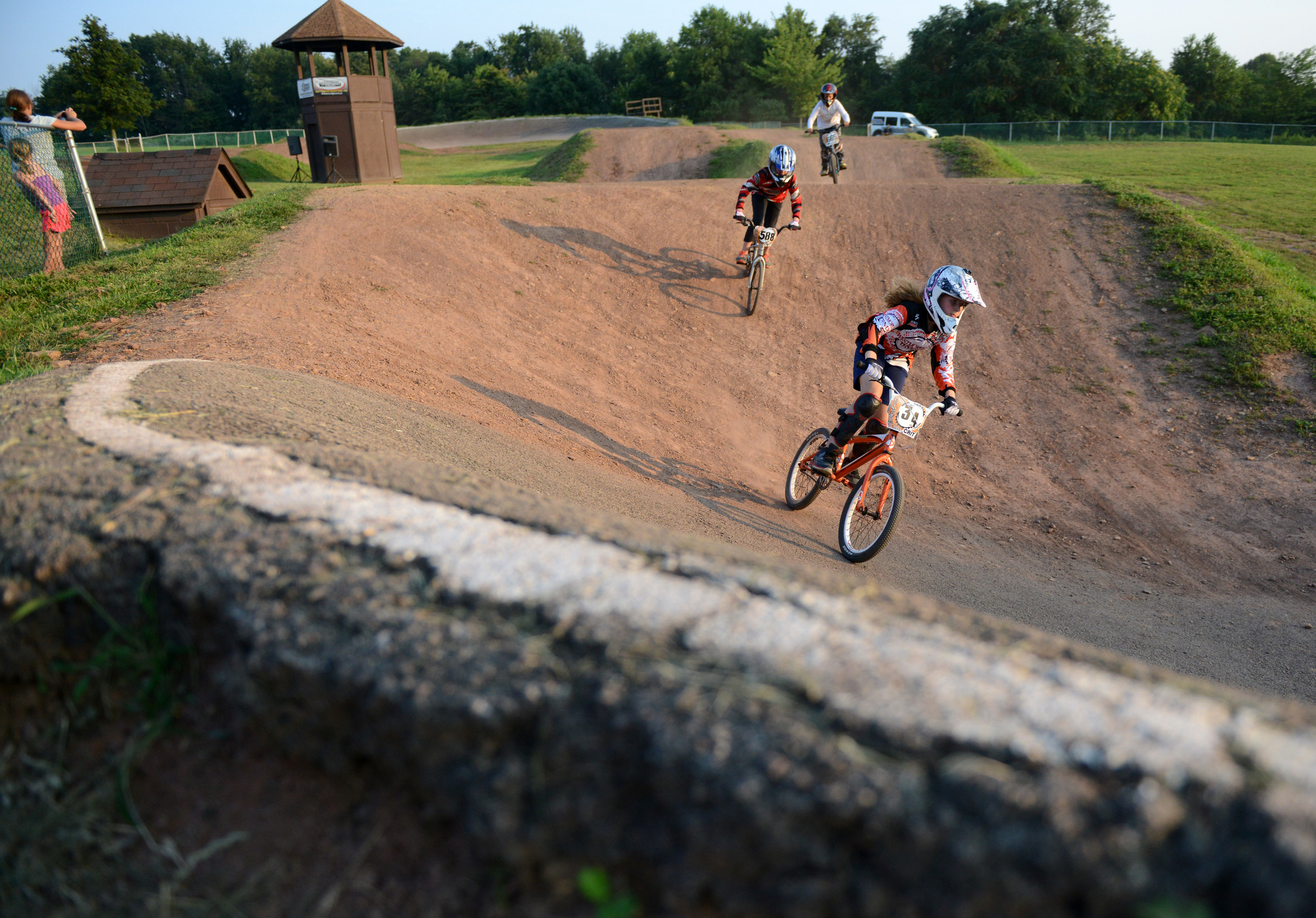 Tasha Kerfonta, of Apollo, takes the lead as she races fellow riders at the BMX Park in Northmoreland Park in Allegheny Township on Tuesday, July 28, 2015.