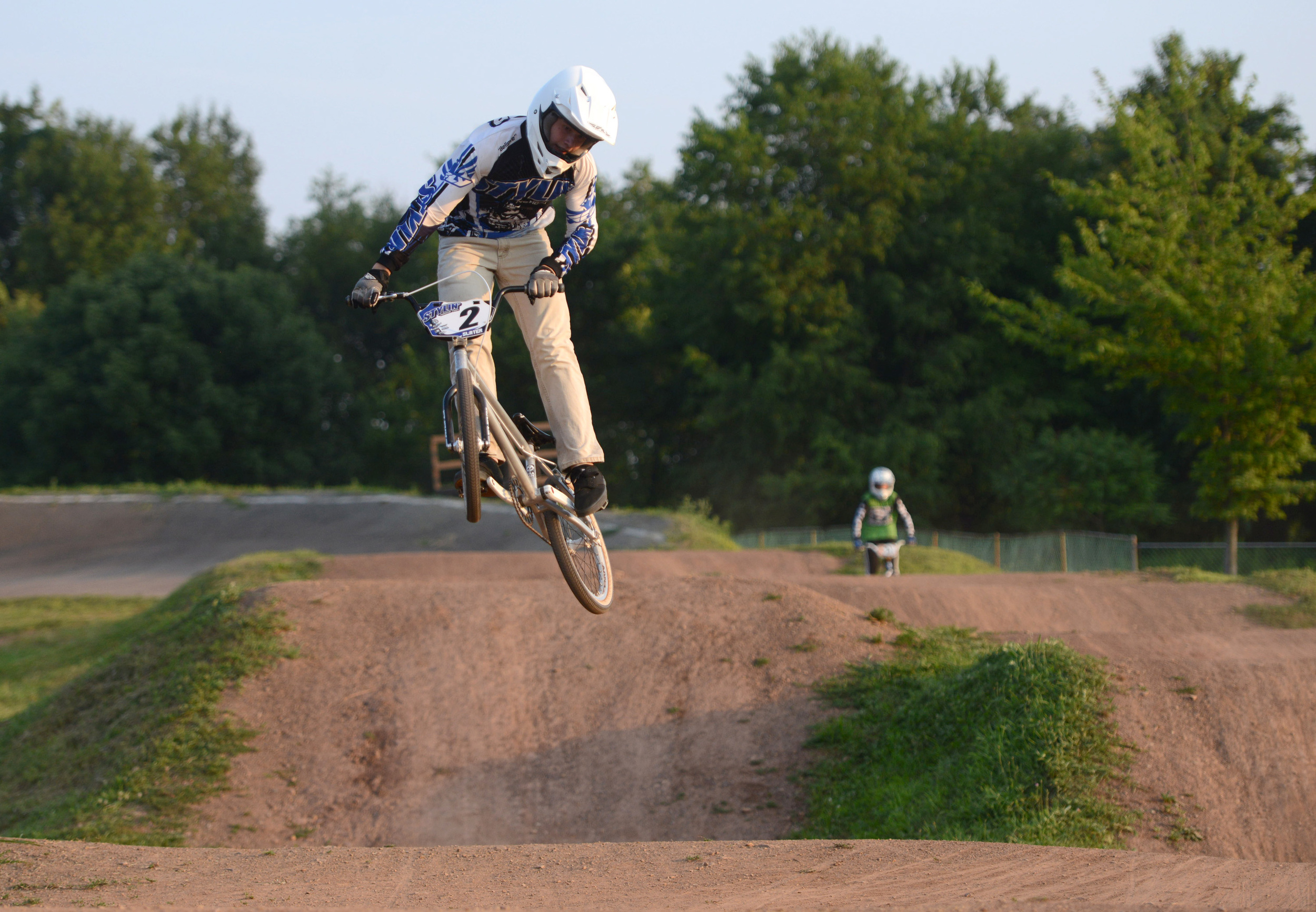 Ean Slater catches some air as he leads his moto at the BMX track in Northmoreland Park in Allegheny Township on Tuesday, July 28, 2015.