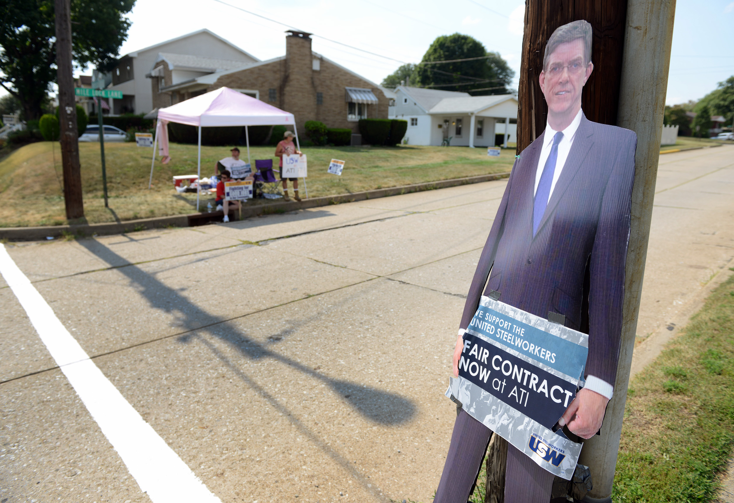"A cardboard cutout of Robert Weatherbee holds a ""Fair Contract"" sign as ATI Steelworkers peacefully show their disapproval while picketing in 90 degree heat near the ATI Allegheny Ludlum Technical Center parking lot in Harrison on Monday, Aug. 17, 2015."