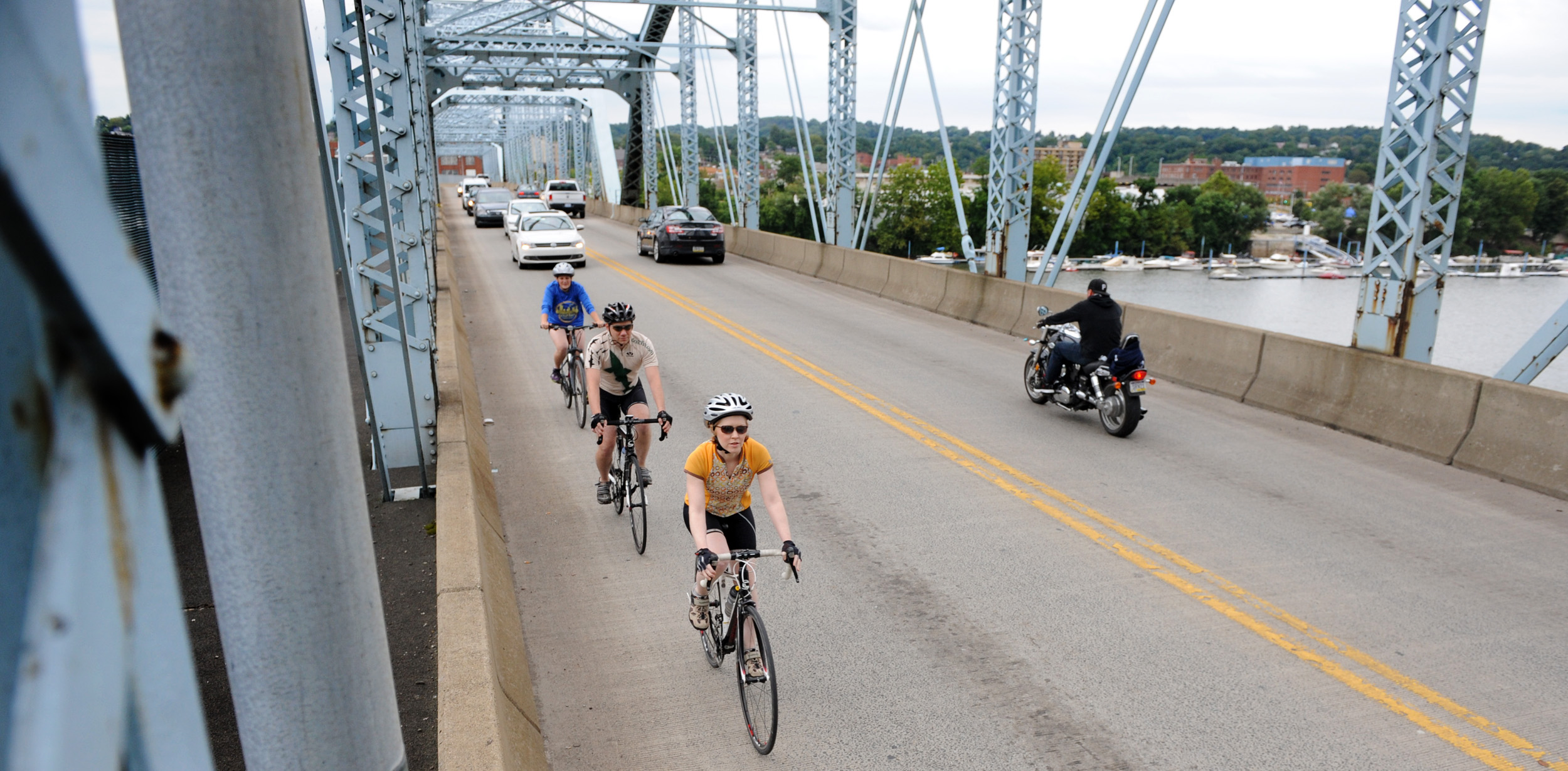 Allegheny Valley Cyclists member Erin Bridgen takes the lead with Sean Brigden and Danyelle Hooks as they bicycle through the 9th Street Bridge in New Kensington on Tuesday, Aug. 25, 2015.