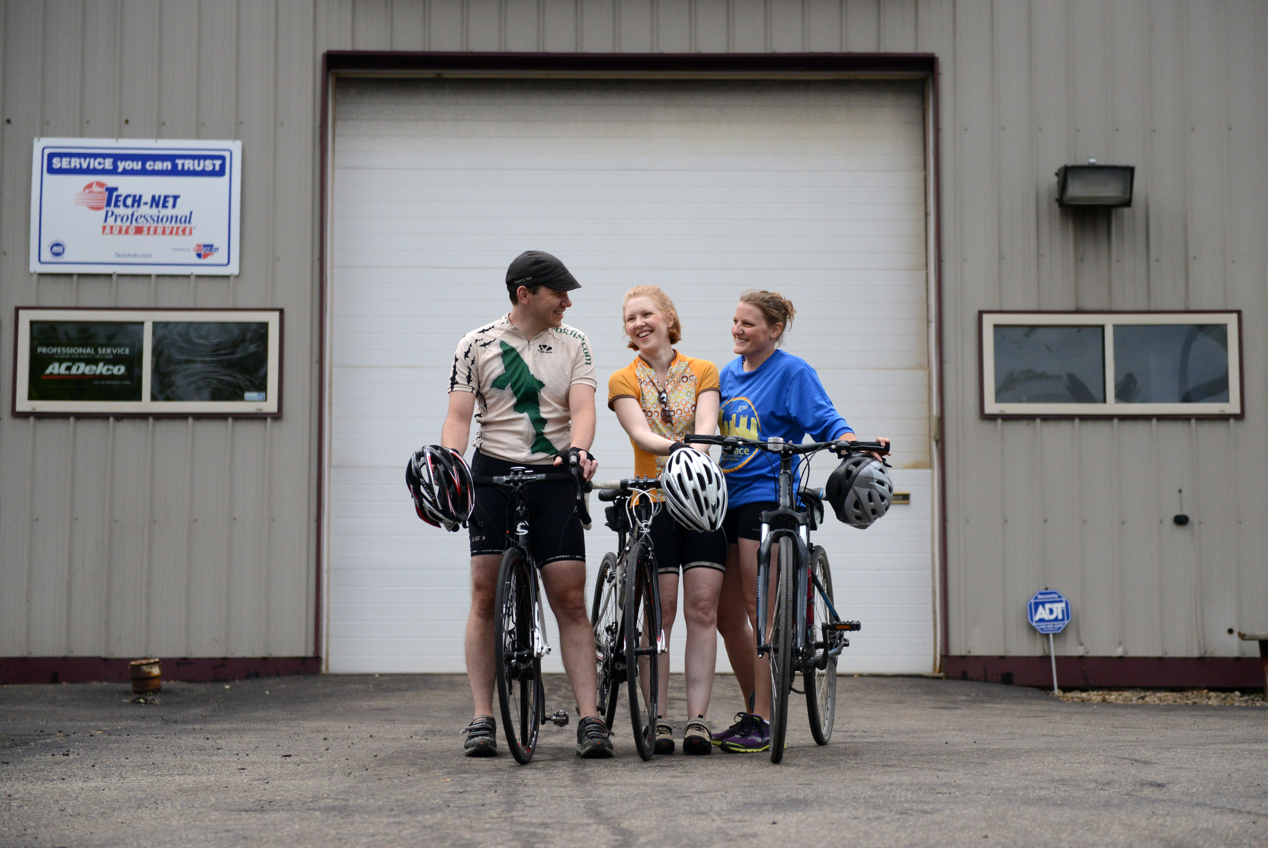 Members of the Allegheny Valley Cyclists (from left) Sean Brigden, Erin Bridgen, and Danyelle Hooks, share a laugh in Creighton on Tuesday, Aug. 25, 2015.