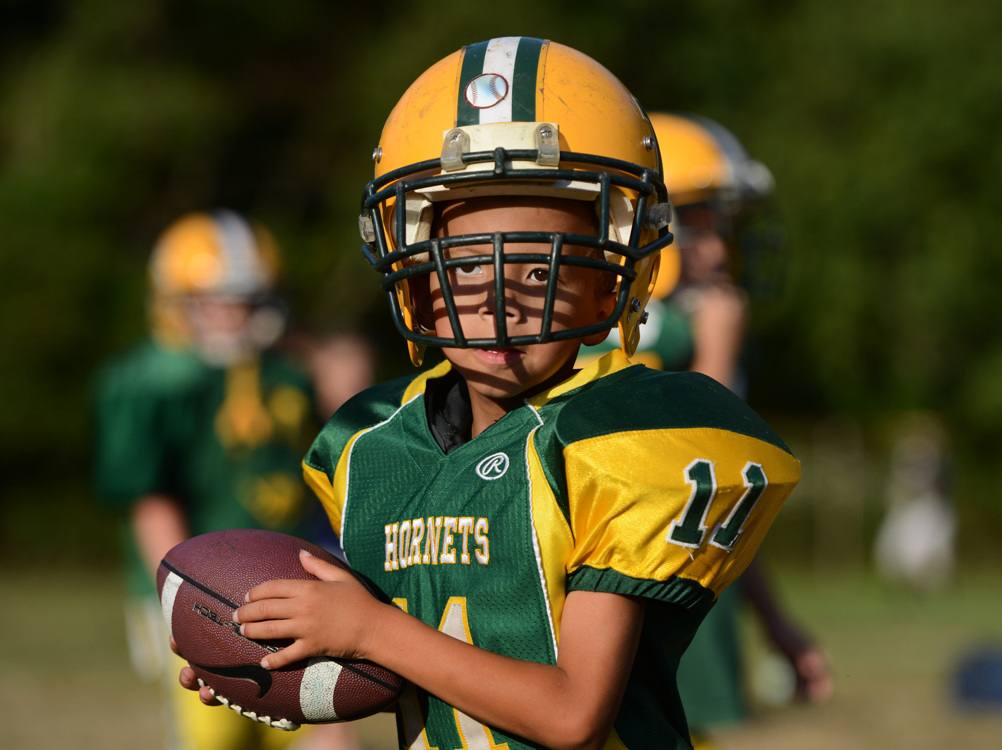 "6-year old Anton ""Tubby"" Clayborn Jr. prepares to throw a pass during football practice at Bushman Stadium in Harrison Township on Tuesday, Sept. 15, 2015. On Saturday, the Highland Hornets youth football team arranged for Anton to make a touchdown against the Butler Knights. Anton has a rare brain disorder that has required many surgeries and is mostly on the sidelines as he cannot be tackled."