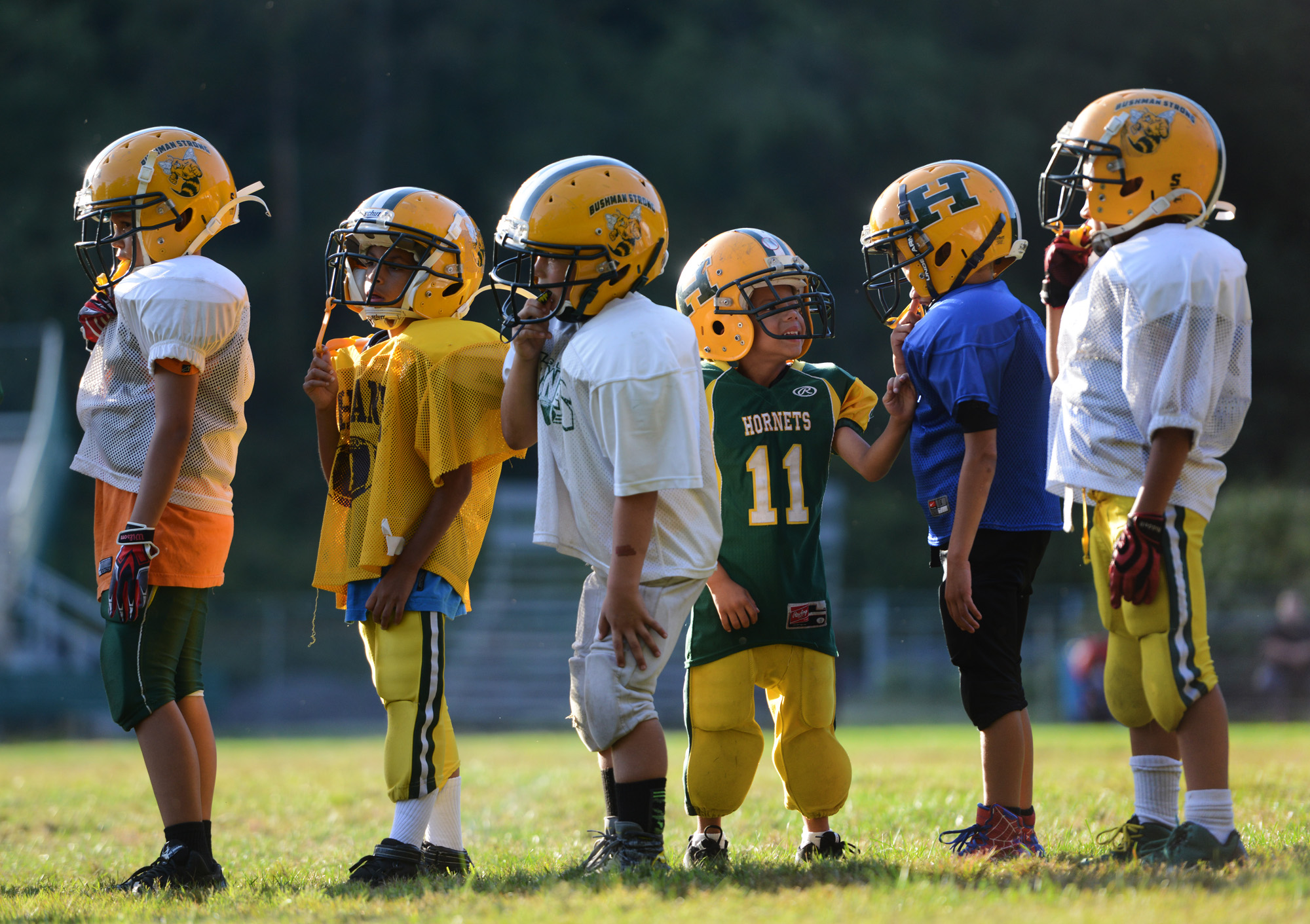 "6-year old Anton ""Tubby"" Clayborn Jr. (11) jokes around with a teammate during football practice at Bushman Stadium in Harrison Township on Tuesday, Sept. 15, 2015. On Saturday, the Highland Hornets youth football team arranged for Anton to make a touchdown against the Butler Knights. Anton has a rare brain disorder that has required many surgeries and is mostly on the sidelines as he cannot be tackled."