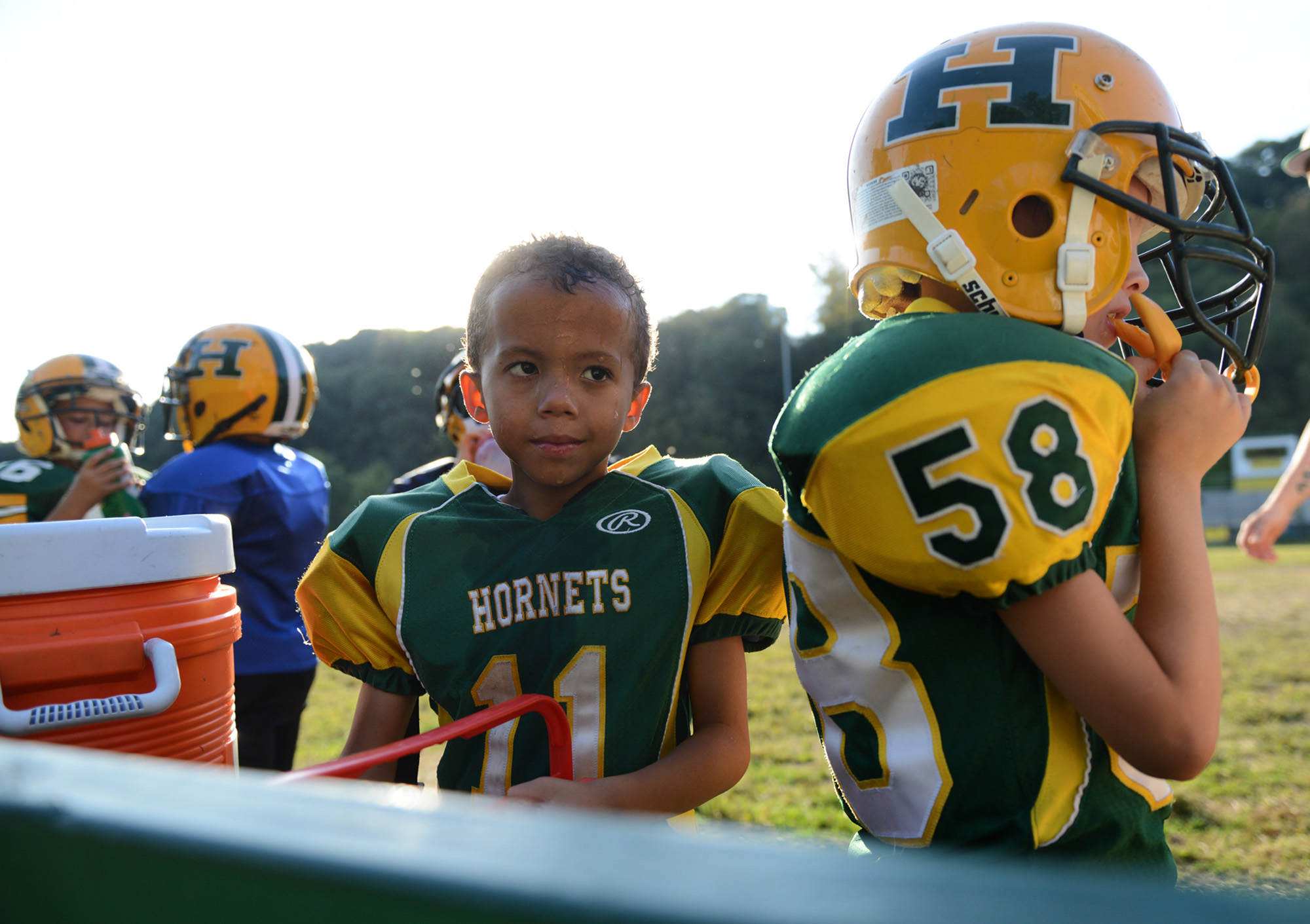 "6-year old Anton ""Tubby"" Clayborn Jr. (11) smiles while taking a break during football practice at Bushman Stadium in Harrison Township on Tuesday, Sept. 15, 2015. On Saturday, the Highland Hornets youth football team arranged for Anton to make a touchdown against the Butler Knights. Anton has a rare brain disorder that has required many surgeries and is mostly on the sidelines as he cannot be tackled."