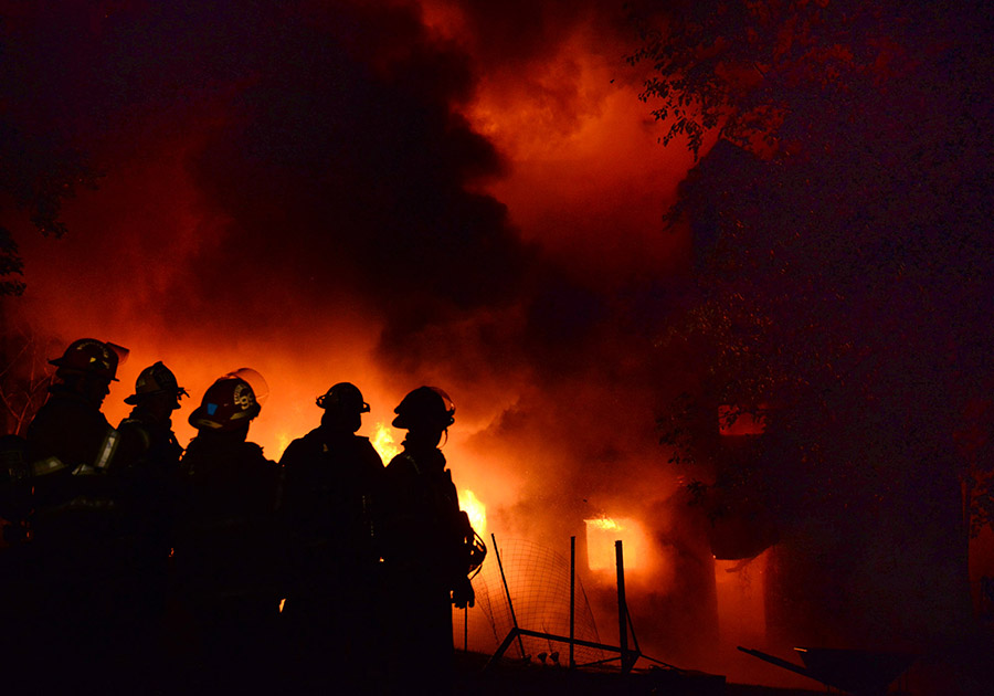 Firefighters work the scene of a residential structure fire on Orr Avenue in Allegheny Township on Monday, Oct. 5, 2015.