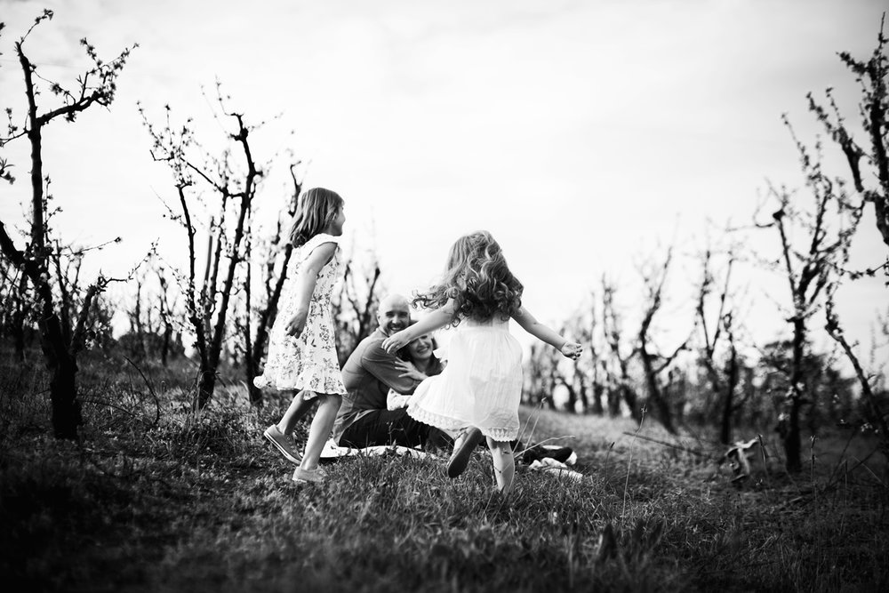 Lifestyle photographer, Cindy Cavanagh, captures fun family portraits in a Sydney orchard.