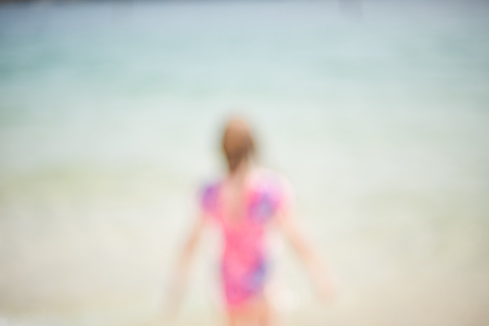 Sydney Lifestyle Portraits by Cindy Cavanagh. A girl swims at Nielsen's Park, Vaucluse.
