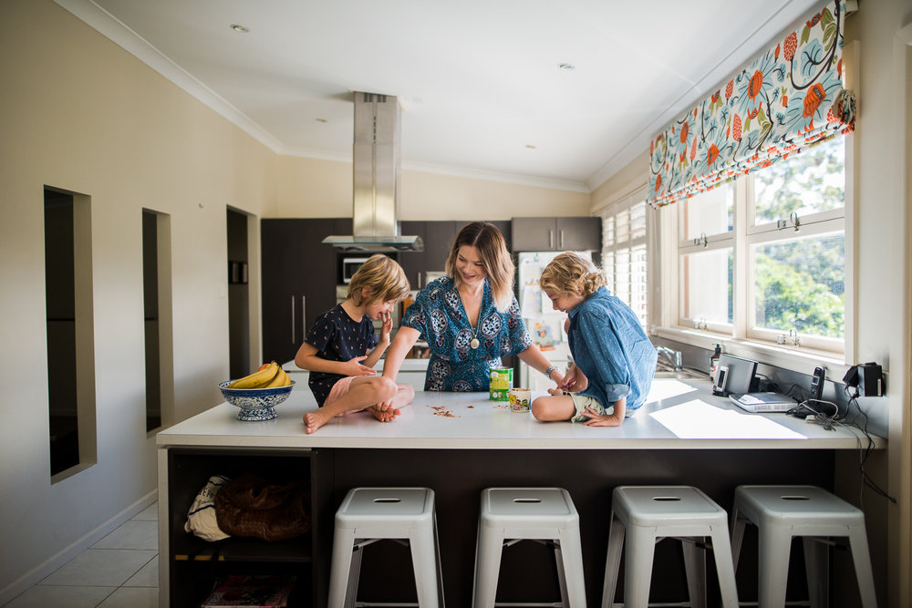 Making Milo and new memories in the kitchen during a motherhood session by Cindy Cavanagh.