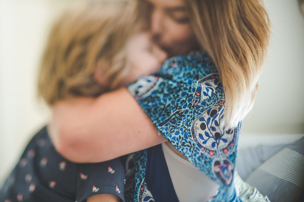 An emotional portrait of a Mum embracing her son. Captured by Cindy Cavanagh during a lifetsyle session in Wollongong.