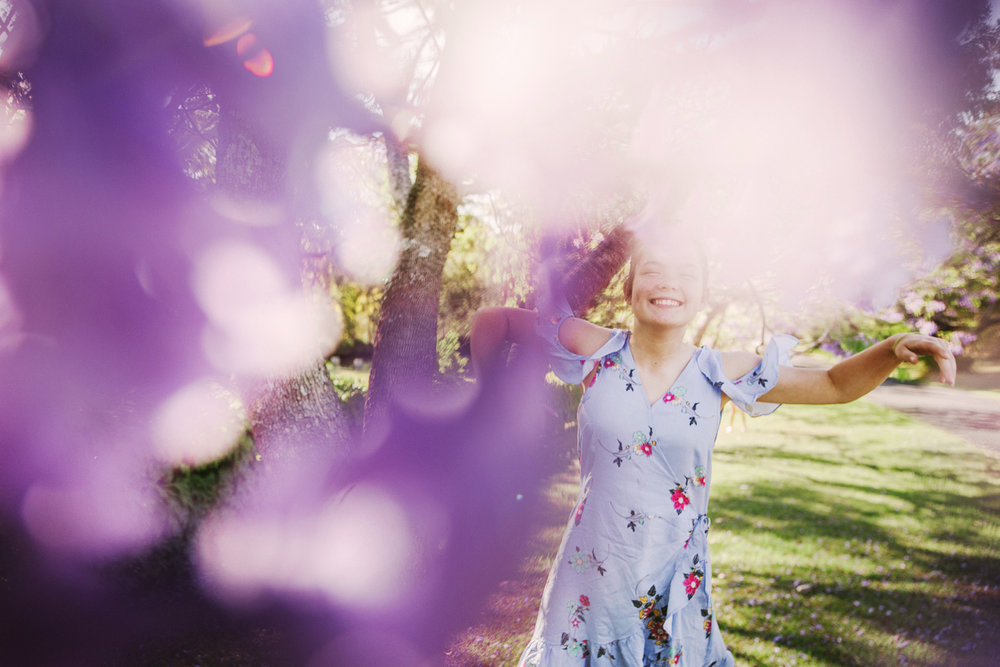 Jacaranda blossoms in Sydney make a beautiful background for lifestyle portrait sessions.
