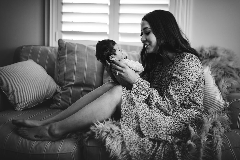 baby-photos-sydney-a new-mum-smiles-at-her-baby-boy