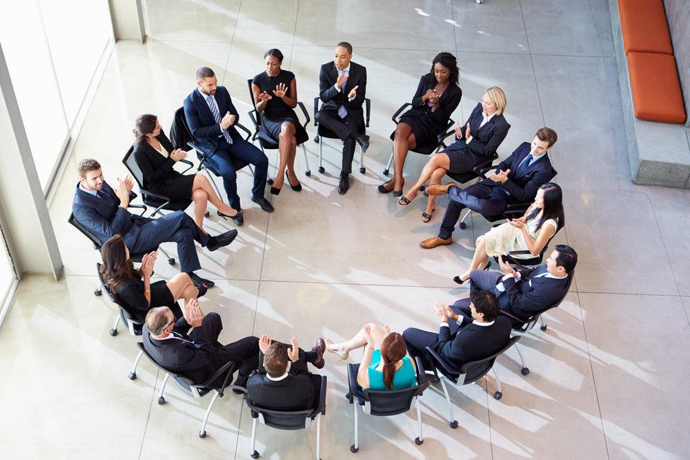 multi-cultural-office-staff-applauding-during-P7HSSPX.jpg