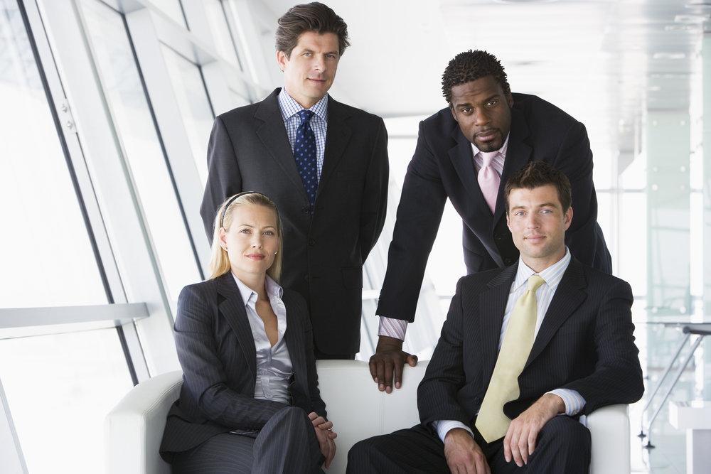 four-businesspeople-in-office-lobby_SK-9VTTBo.jpg