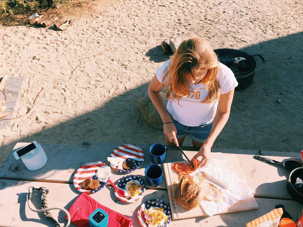 andreina-fixing-breakfast-campsite