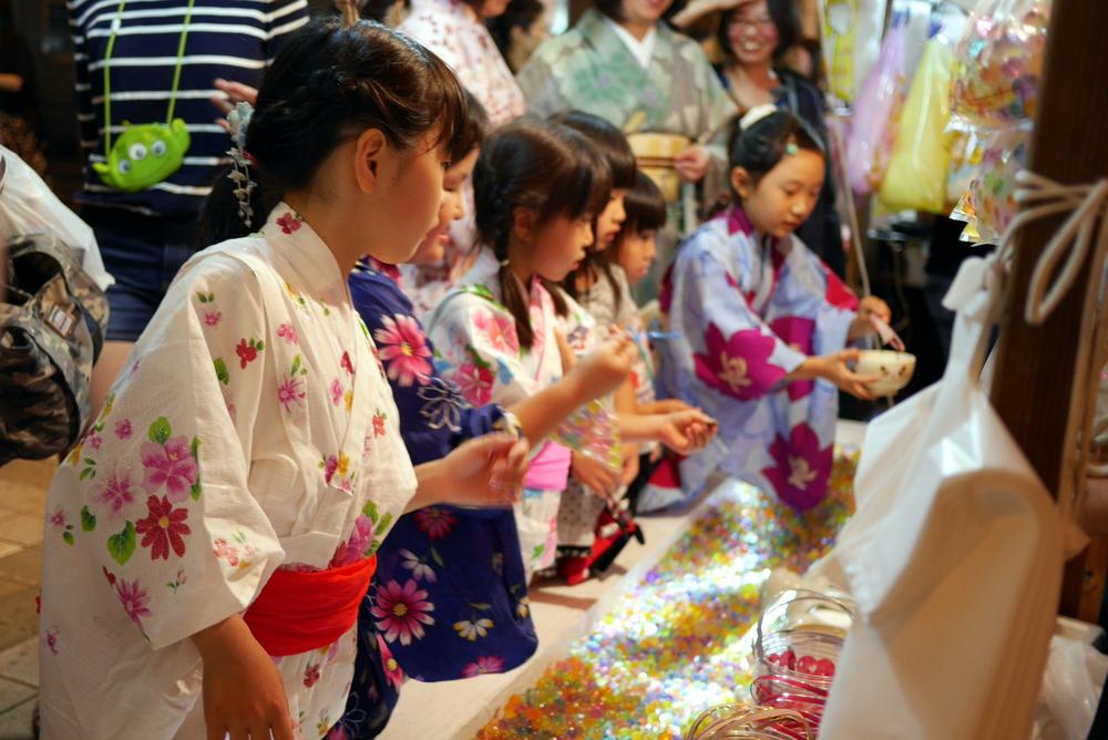Young girls playing a game at the Hiroshima Yukata Festival