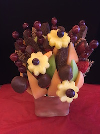 Applelicious Bouquet  A wonderful variety of honeydew, cantaloupe, grapes, strawberries plain and dipped in milk chocolate. This one also has added apples with skor and milk chocolate.  $65/$75/$85   Send Request