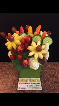 Garden Bouquet  A crunchy delight of fresh veggies, grapes, strawberries and pineapple  $50/$60/$70