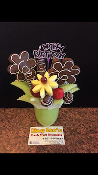Birthday Mini  This birthday bouquet has honey dew strawberries and apples dipped with milk and white chocolate. With age added to pineapple daisies.  $40