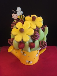 Bee Happy  Large  Honeydew melon, strawberries plain and milk chocolate with pink swirls and pineapple daisies   $65   Send Request