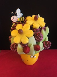 Bee Happy Medium  Honeydew melon, strawberries plain and milk chocolate with pink swirls and pineapple daisies  $60   Send Request