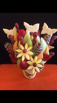 Sympathy Bouquet  This bouquet has both plain and chocolate dipped berries, cantaloupe, honey dew, grapes and pineapple dipped butterflies.(we can make this with honeydew also added)  $55/$65/$75   Send Request