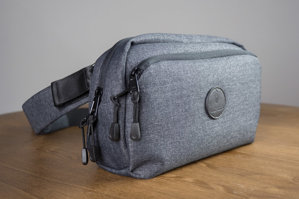 Go Sling - Light, versatile, camera sling designed for the urban traveller. Carries all your essentials: phone, camera, passport, wallets, keys, etc.It fits perfectly inside the 7ven Messenger.