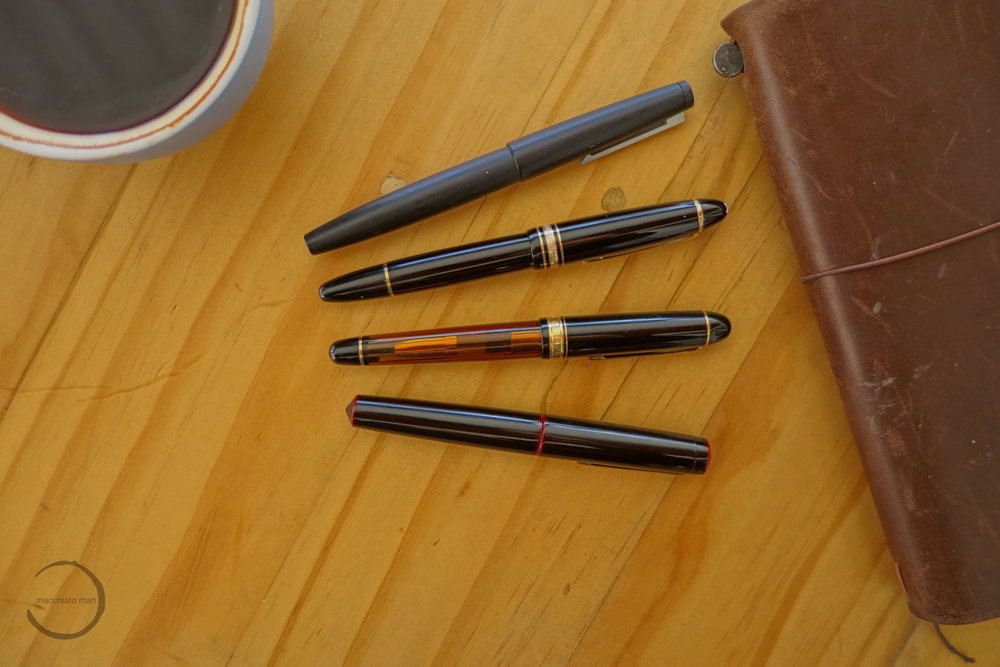 "From top: Lamy 2000, Montblanc 149, Platinum Century #3776 ""Gengetsu"", and Nakaya Piccolo Writer"