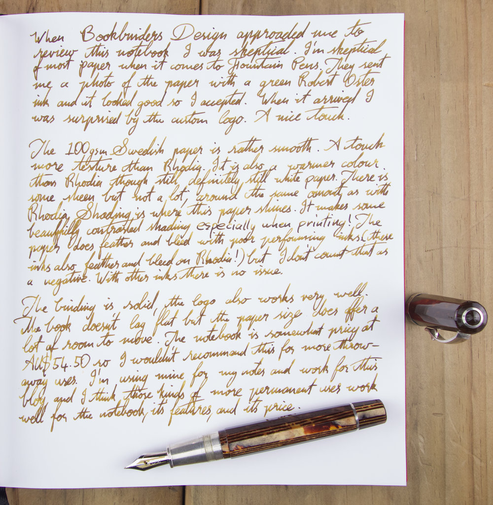 Hand-written review with KWZ Honey in an OMAS Paragon Arte Italiana Arco Celluloid with Silver trim