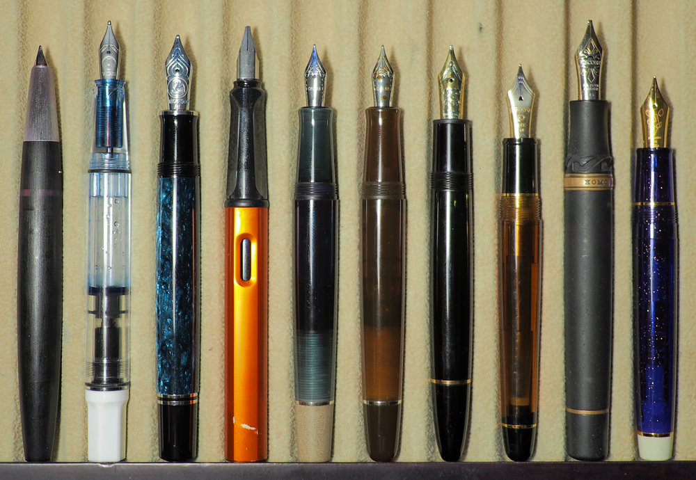 Left to right: Lamy 2000, TWSBI Eco, Pelikan M805, Lamy Al-Star, Opus 88 Koloro, Opus 88 Picnic, Montblanc 146, Platinum Century #3776, Visconti Homo Sapiens, and Sailor Pro Gear.