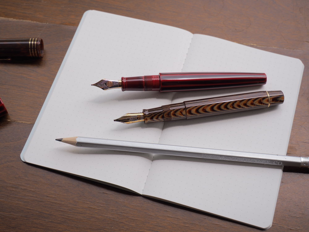 Pens and Pencil on Notebook 1.JPG