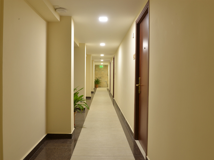 The hallway to the Guest Rooms at Champa Central Hotel