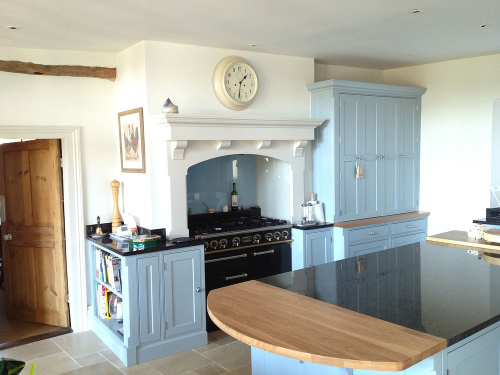 The new hand-built, solid wood and granite kitchen