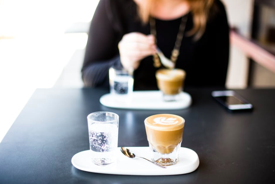 Source: https://www.pexels.com/photo/selective-focus-photography-of-blended-caffeine-near-woman-about-to-stir-coffee-139539/