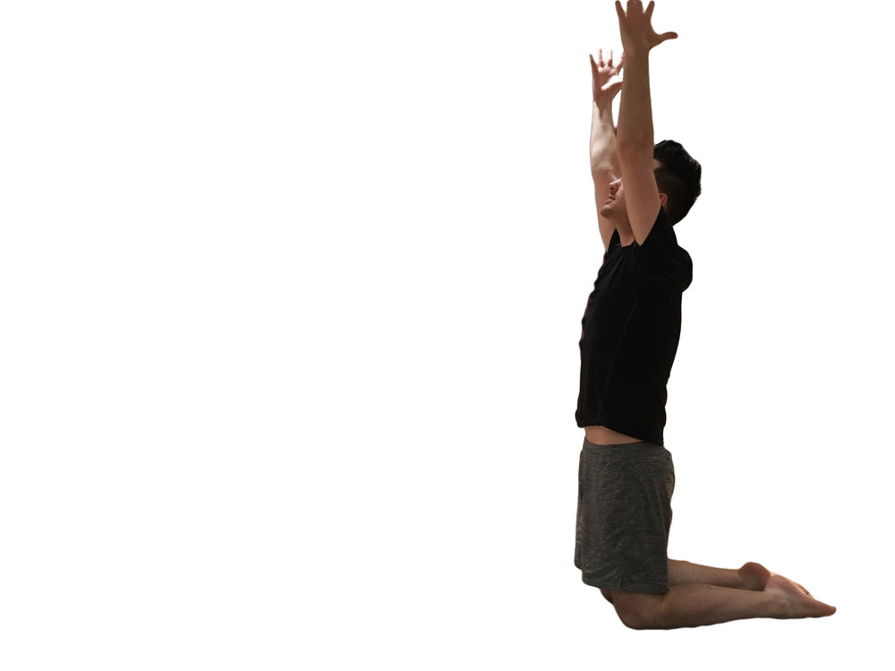 2. As you breathe out, lift up onto your knees and straighten your arms, reaching upwards