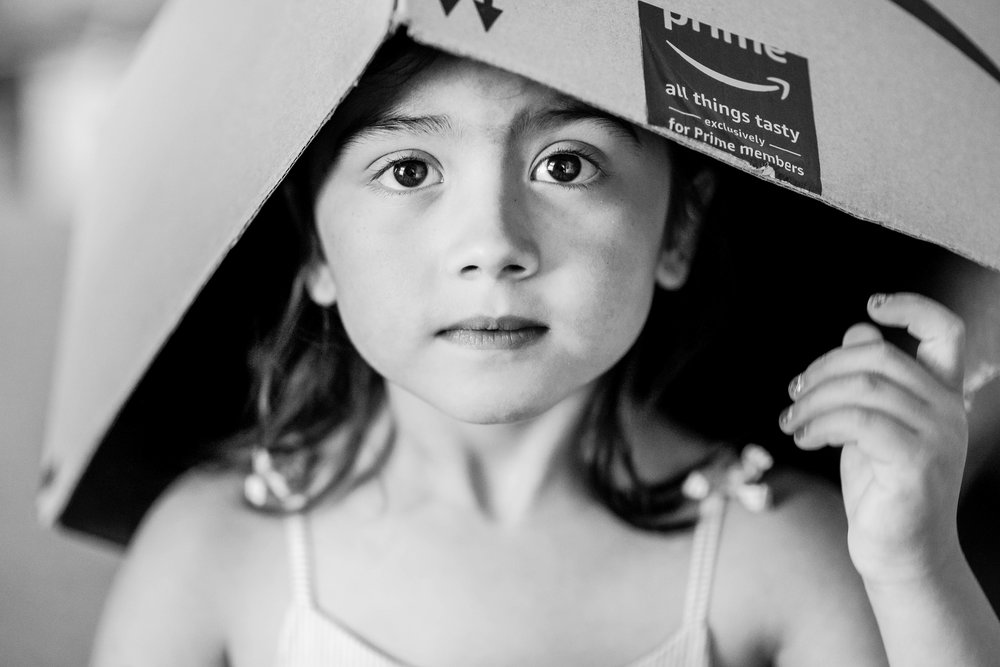 Girl with box on head Playful Family Photography