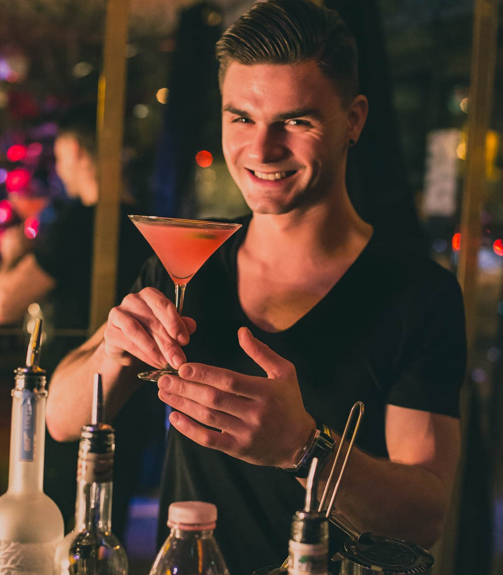A Cosmopolitan cocktail served with a smile from the bar