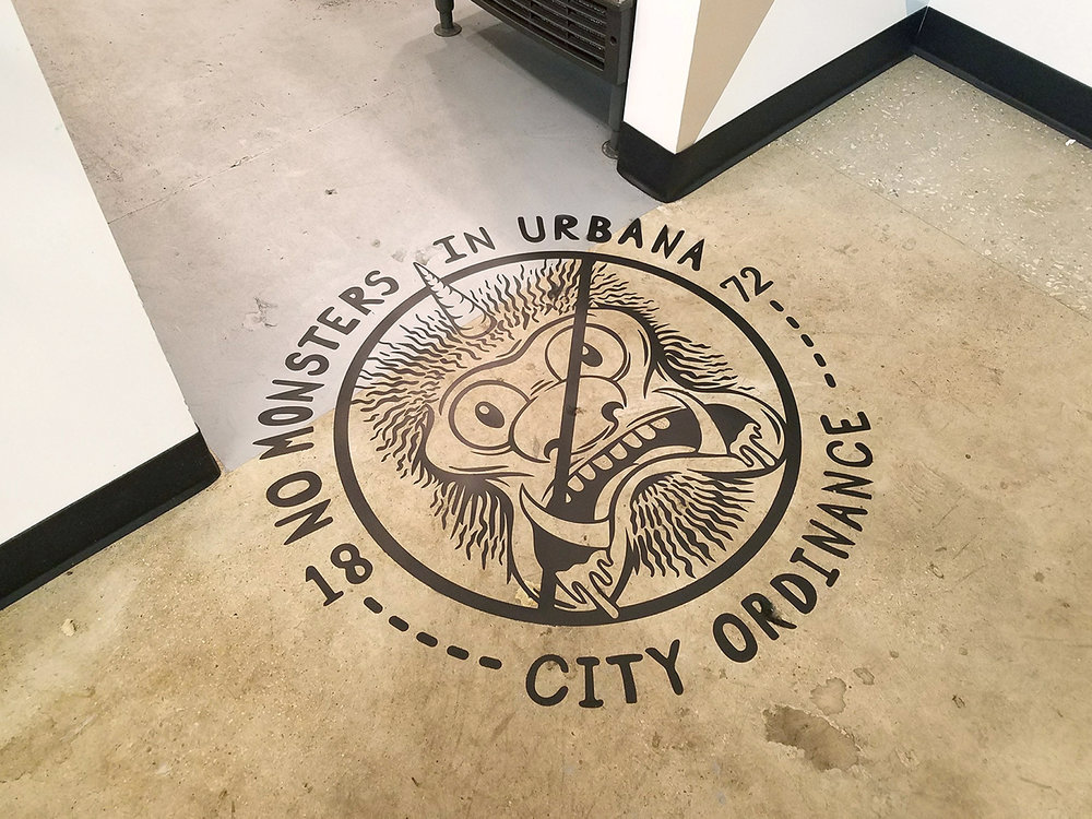 In 1817, the city of Urbana, IL outlawed monsters within its borders. Brewlab requested a floor graphic/sticker illustrating this antiquated law.